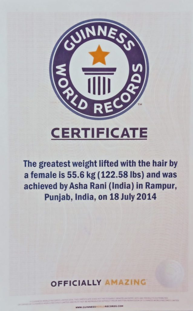 pulling weight with hair, guinness world records , book of records, guiness records, world record